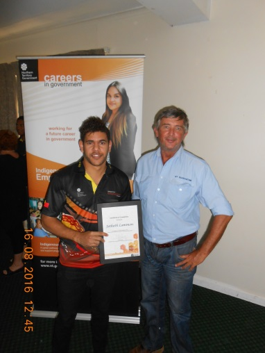 Yeppy Lammon being congratulated by Rod Freeman for graduating from Charles Darwin University with his Certificate II in Business