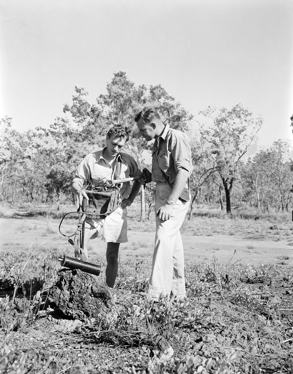 Geophysicist Don Dyson (left) and Geologist Hector Ward use a Geiger counter to examine a mineral outcrop in a belt of uranium bear (1955) National Archives of Australia: A1200, L19458.