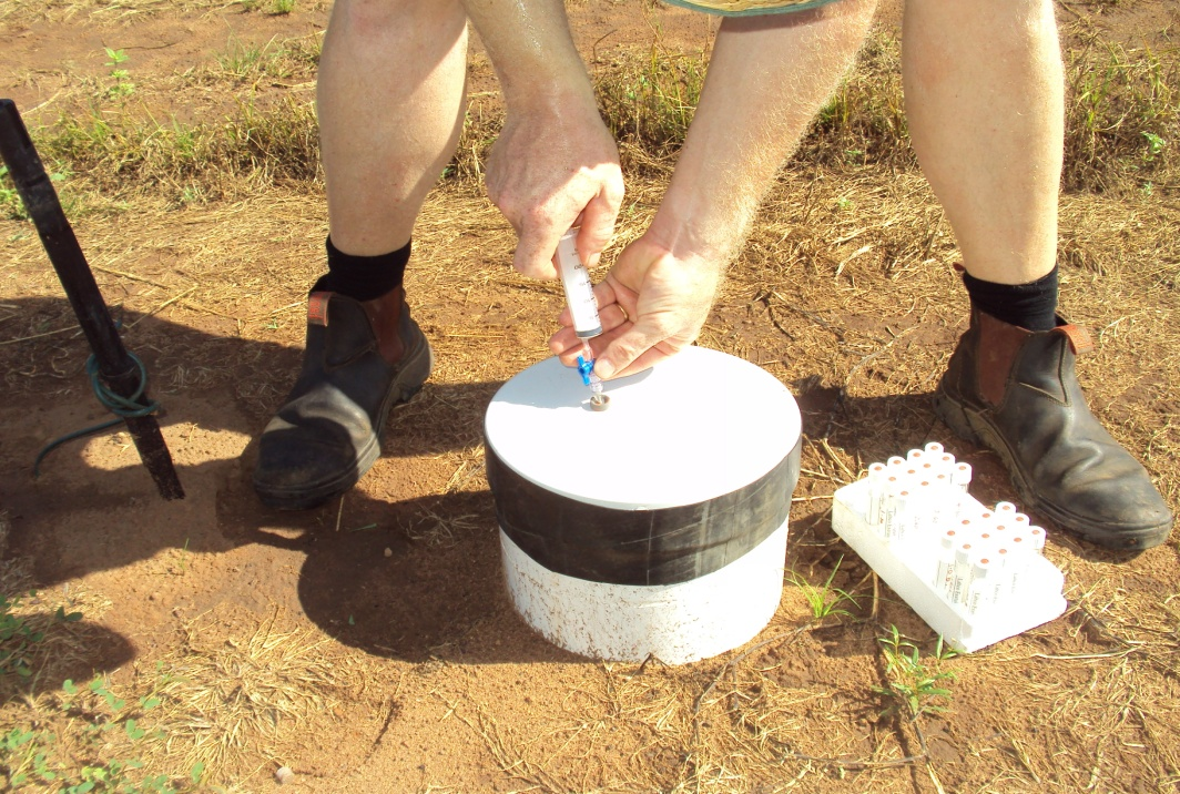 Manually collecting soil gas samples at a Darwin farm