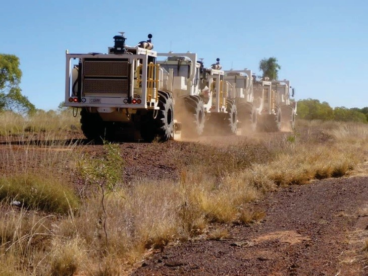 Vibroseis trucks alongside the Barkly Highway, Queensland, working on the South Nicholson Basin seismic line