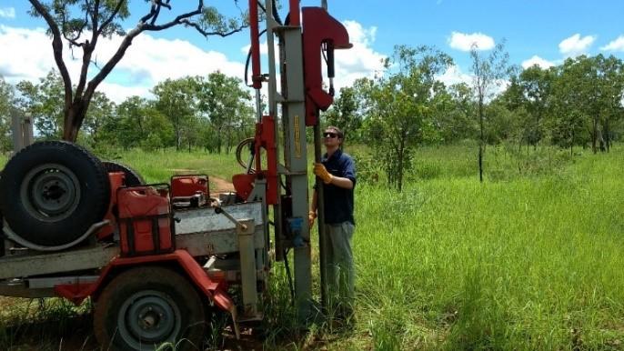 Image: Patric Burly demonstrating DENR's hydraulic soil sampling drill