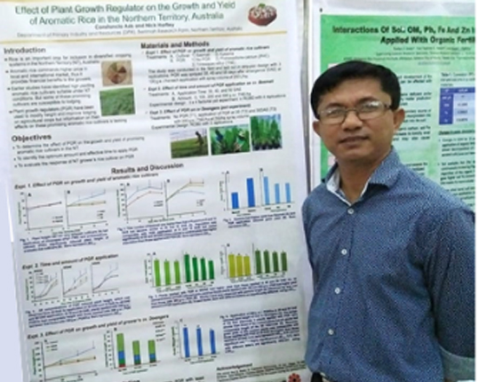 Tony Asis with his prize winning poster at the recent 21st annual Philippine Society of Soil Science and Technology conference.